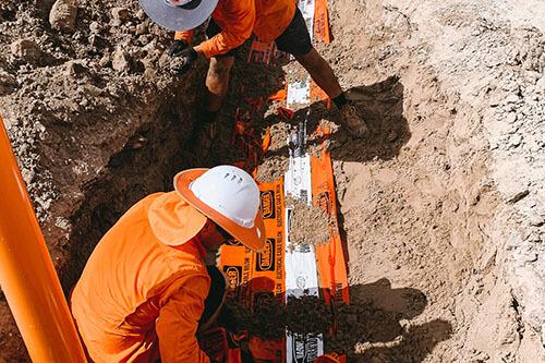 Industrial Electrics team digging